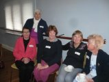 Groups of School volunteers in their teams enjoying  Volunteer Exchange Network event