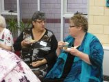 Principal of Maidens Park PS enjoys morning tea at the Volunteers Network Exchange and chats with HU4K volunteers