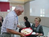 Steering Committee Stephen hands around a plate of home cooked scones, jam and cream at a Volunteer Networking Exchange meeting where all volunteers get together.