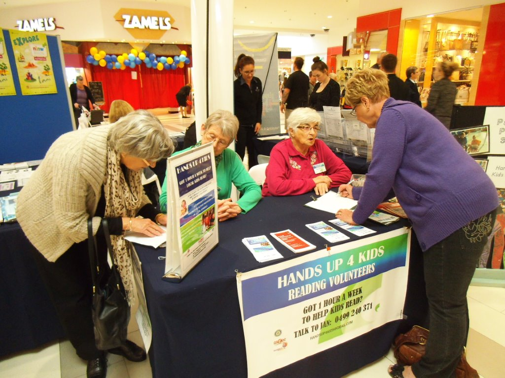 A passer-by signs up for HU4K at the Centrepoint Shopping Centre Literacy Week HU4K recruitment table